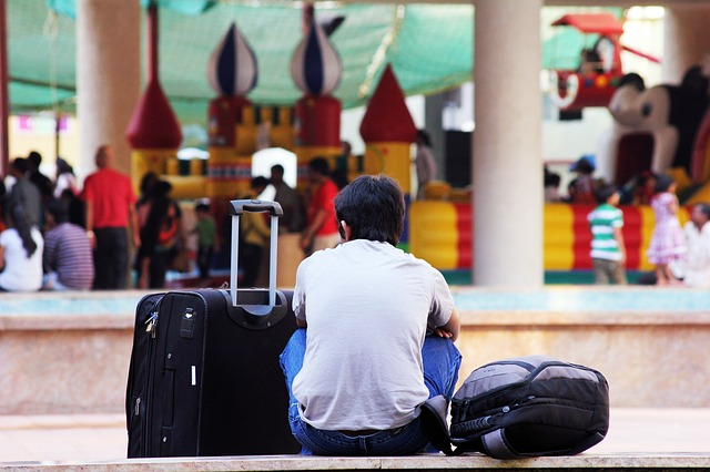 Picture of man sitting with his luggage